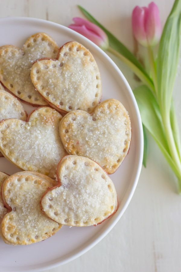 Heart shaped hand pies filled with strawberry preserves and sprinkled with sparkling sugar!