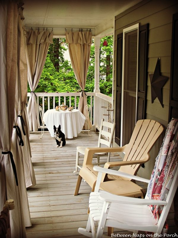Porch with Curtains- I like this so that we can have privacy from neighbors and step the front porch up a notch. I've seen some homes with sheer ones as well and it looked great.