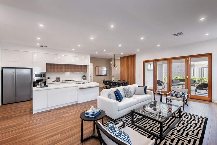 This gorgeous open plan living area is sure to take your breath away. #weeksbuildinggroup #newhome #homedesign