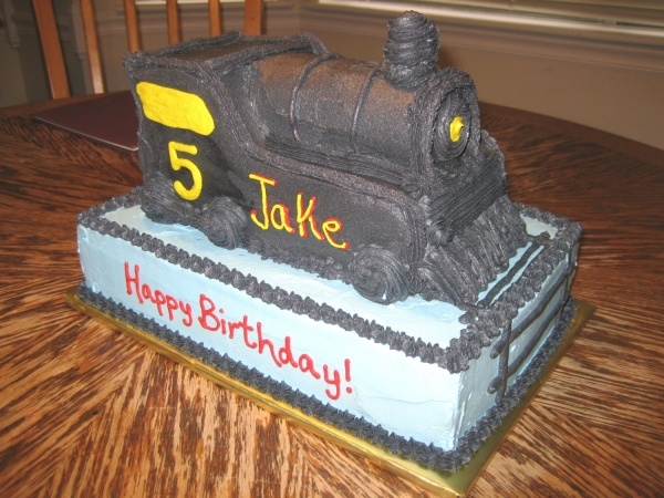 polar express cake @Maureen Mills Cunningham this is the train Casen wants. He is turning 2. Would you be able do make a funfetti flavored cake and use a buttercream icing (I'm not a huge fan of fondant). Just the train will work...we do not need the sheet cake underneath. Enough for 20-30 people. You can do all of the lettering in Red.