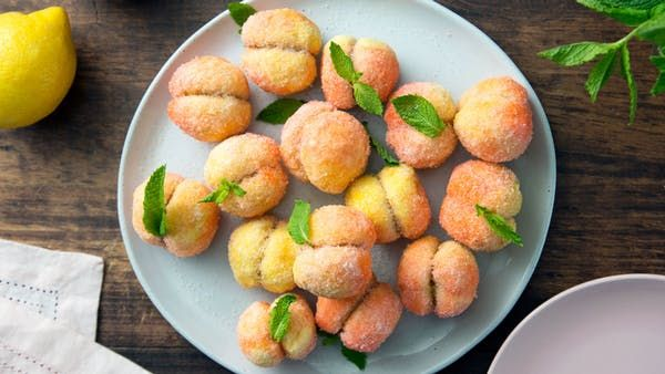 Recipe with video instructions: Be a peach and try these perfectly ripe cream-filled cookies made to resemble your favorite emoji. Ingredients: For the pastry cream:, 1 3/4 cups whole milk, Rind of one lemon, cut in strips, 4 large egg yolks, 3/4 cup sugar, 1/4 cup all-purpose flour, 1 teaspoon Luxardo liqueur, For the cookies:, 4 cups all-purpose flour, 1 tablespoon baking powder, 3 large eggs, 3/4 cup sugar, plus more for decoration, 2 tablespoons peach schnapps, 3/...