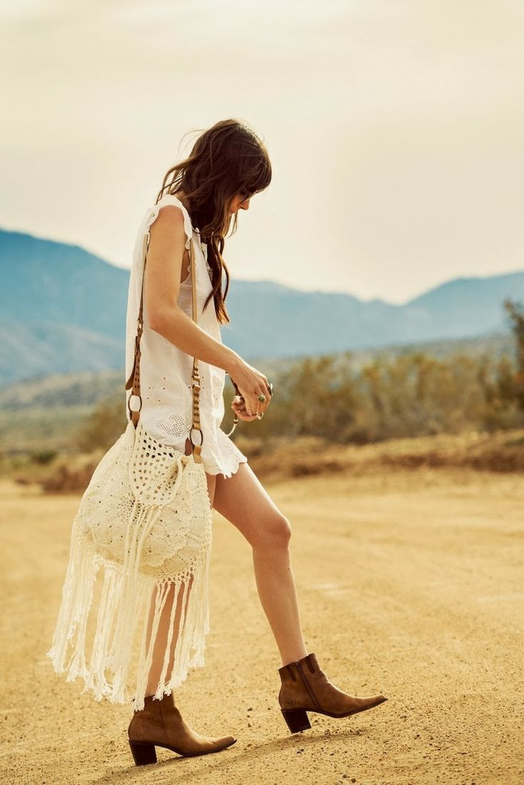 That purse is super cute! We have a clutch sized version very similar to this look.