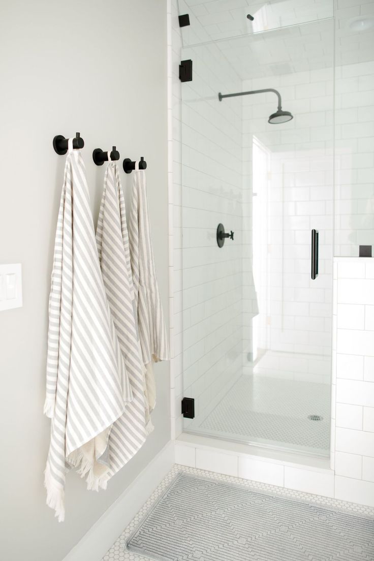 Bathroom with cool tones, black hardware - Studio McGee Blog
