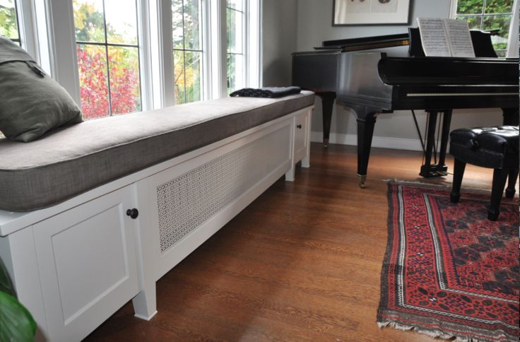 I have been looking for this very project to do in my bedroom!!!!      Radiator cover that doubles as window seat