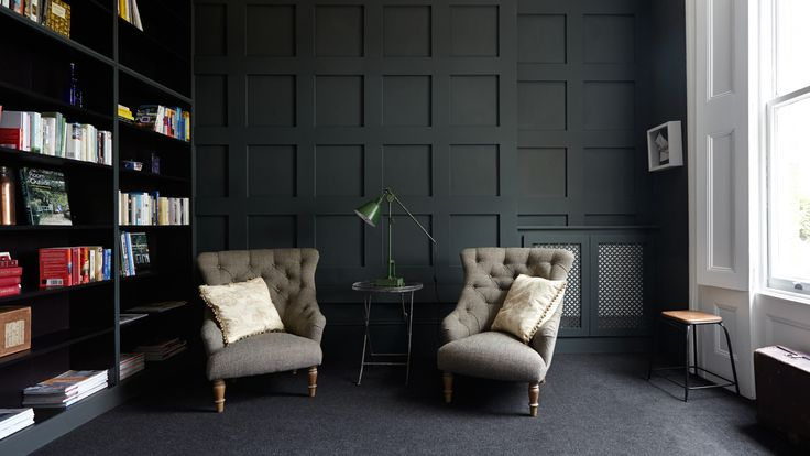 Masculine grey home library with panelled wall