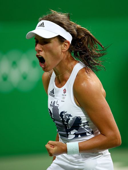 Johanna Konta of Great Britain celebrates after victory over Stephanie Vogt of Liechtenstein in their singles match on Day 2 of the Rio…