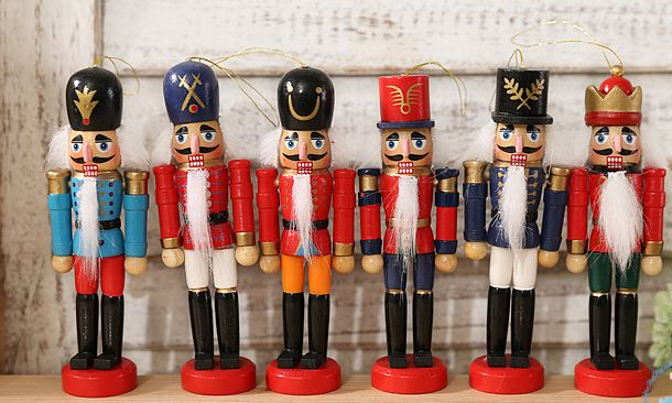 Handmade Christmas Nutcracker Wooden Walnut Soldiers  Traditional Walnut Soldiers have a wooden leaver at the back for mouse. Protecting your family and Good luck to your family. Glitter and Vintage design Nutcrackers are gorgeous table ornaments as well.  Size: 30cm Height (12 inches)             Material: Wooden