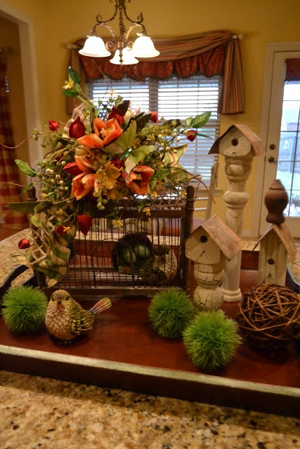 Bird, Nest in Birdcage, & Bird Houses on Tray for spring décor. Love the floral arrangement on top of the birdhouse.