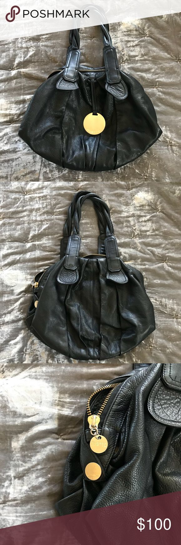 Black Gusto handbag pebbled leather Great condition black pebbled leather Gusto shoulder handbag.  Gently used, but used very little. Gusto Bags Shoulder Bags
