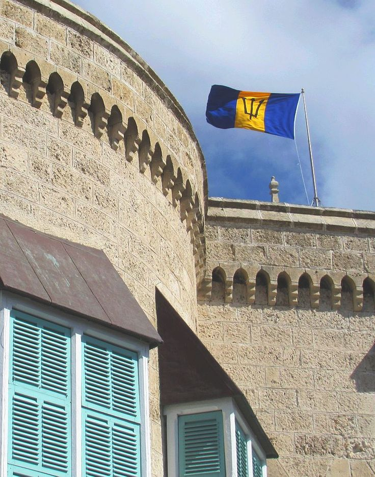 The #Barbados flag flying over Parliament Buildings. Blue represents the sea and sky of Barbados, while gold represents the sand of the island's beaches. The symbol at the centre of the flag represents the Trident of the mythical sea god, Neptune - the shaft of the trident is broken symbolising Barbados' break from Britain upon becoming an independent nation on November 30th 1966.