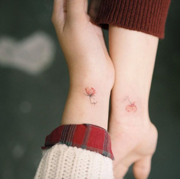Matching Floral Wrist Tattoos by Sol Art