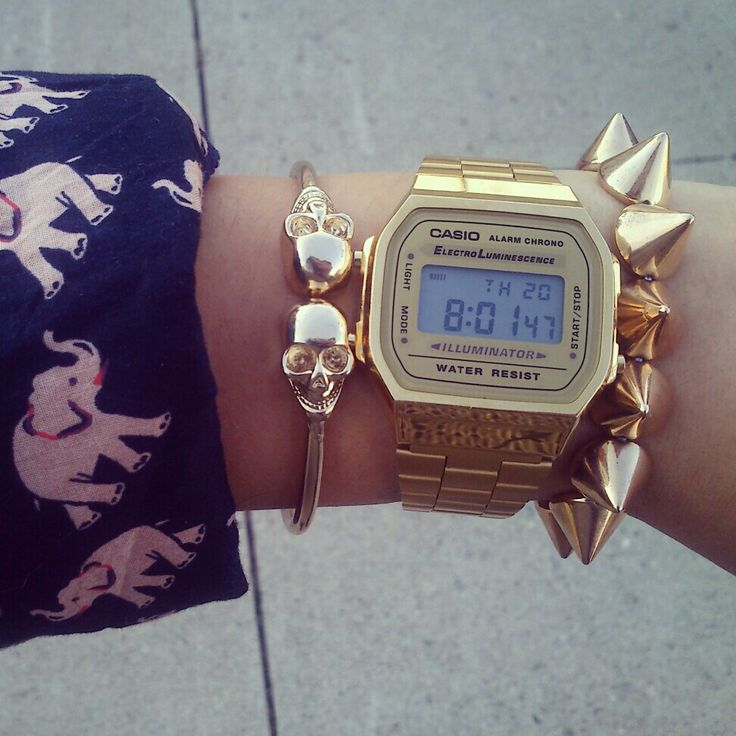 Gold Casio watch, gold skull bracelet