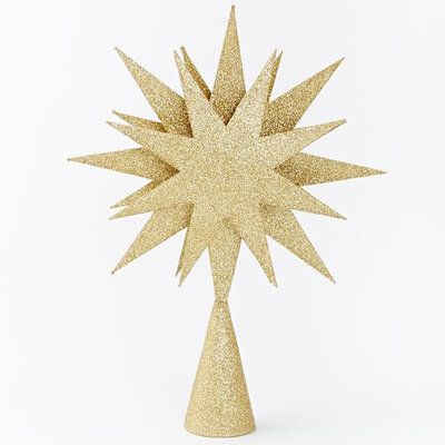 Coastal Tree Toppers: Made of Kraft paper and glitter, this gold star radiates a do-it-yourself glow … without actually having to do it yourself. | CoastalLiving.com
