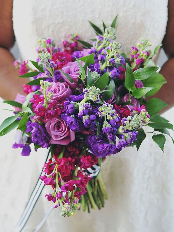 Bright pink and purple wedding bouquet with roses and stock flower