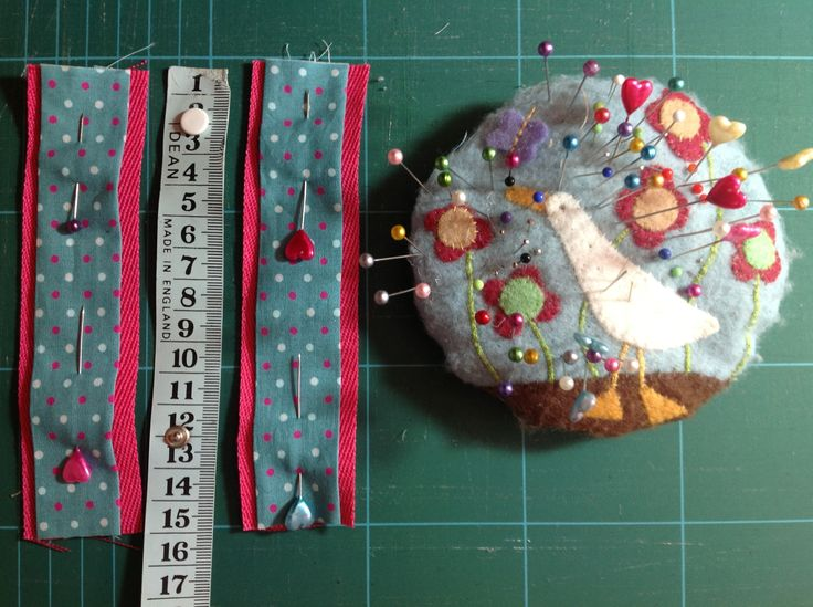 My pin cushion. Made using felt appliqué in my favourite colours, stuffed with crushed cocoa shells and backed with vintage Liberty.. Adoreable.