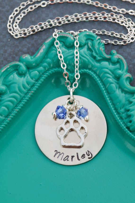 Personalized Dog Necklace • Dog Name • Dog Jewelry • Pet Memorial Gift • Dog Paw • Loss of Dog • New Puppy • Dog Lover Gift • Dog Memorial  Pet necklace, personalized with dog or cats name with paw print charm, handstamped by DistinctlyIvy on Etsy. Great for the pet lover, for a memorial gift, or for a new addition to the family!  ✤ Personalize this in the Note to Seller box at checkout! ✤  More Pet Items: https://www.etsy.com/shop/DistinctlyIvy/search?search_query&#x...