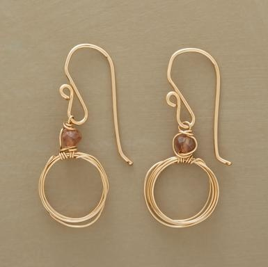 """Wire earrings gold with a glass bead. Dainty 14kt goldfilled circles loop and loop, basking in the halo effect of a lone andalusite bead. Handmade in USA. 1-3/8""""L. $68"""
