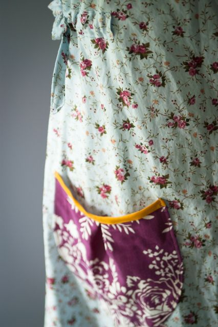 I've run into this charming floral smock here and there on the internet; it's from an Etsy shop called Dottie Angel. It's not curre...