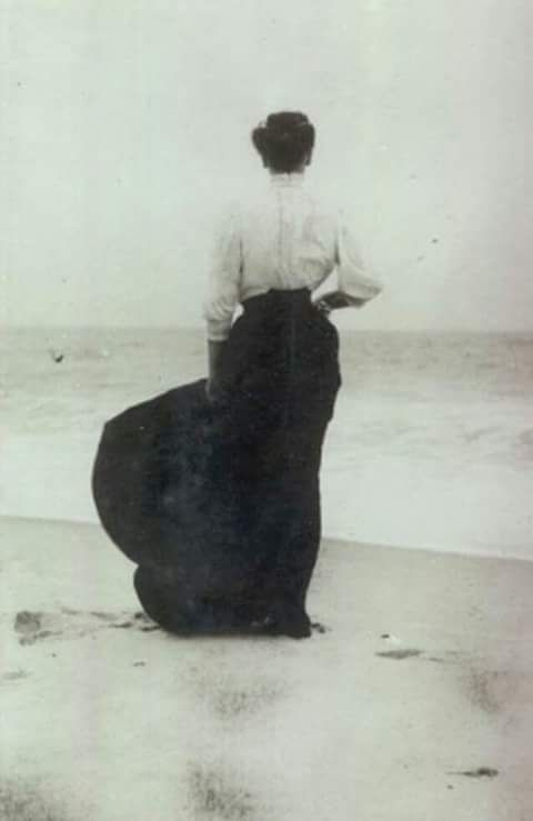 Rare photograph of Lizzie Borden standing on the beach, a few years before she is accused of killing her father and step mother.