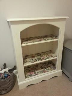 Old pine bookcase transformed for play room storage courtesy of Annie Sloan Original paint and decoupage shelves