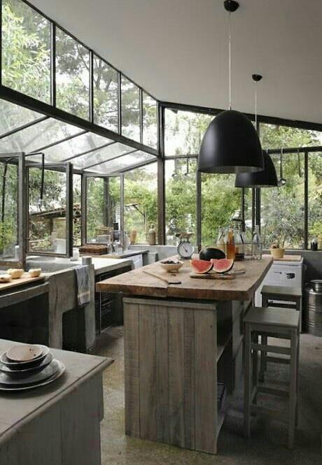The glass wall brings out outside in. Green house turned into a kitchen/ add on to house?