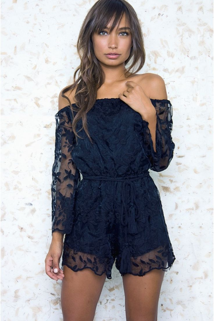 Get sultry in this black lace romper made for your best occasions. The off the shoulder style is a huge trend, and the black lace romper is delicate and stunning. The sleeves are sheer and flared and the shorts have a sheer overlay portion. This romper is belted to accentuate those curves and is the perfect addition to your wardrobe.