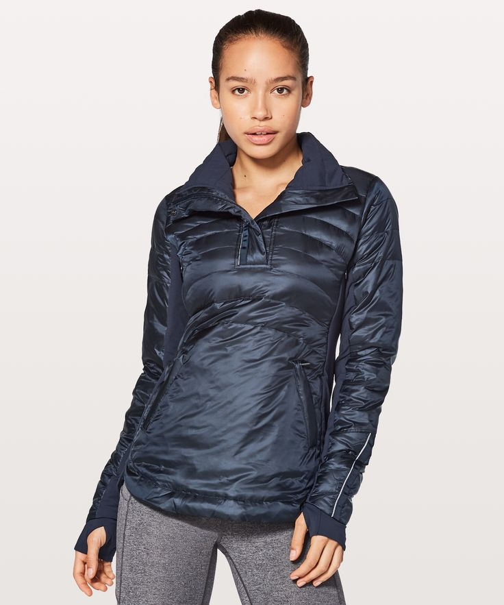 Running in the cold and rain  never felt so good. Made with  800-fill-power goose down and  water-resistant fabric, this  lightweight pullover will keep  you feeling warm and dry