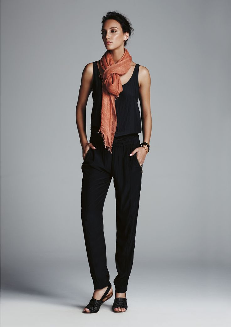 Black slip tank, black soft zip pant and spice gossamer wrap.