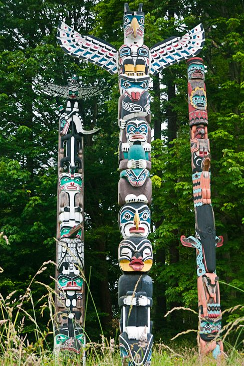 rad totem poles in Stanley Park, Vancouver, Canada