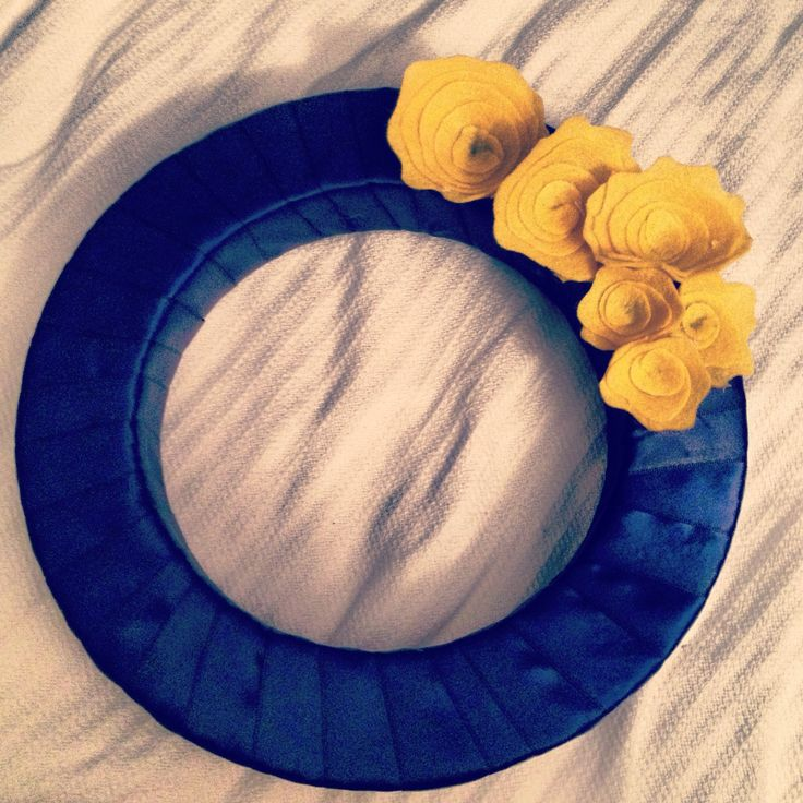 My Reinhardt University wreath made in time for the third football game. Gold felt flowers with navy blue ribbon wrapped around a styrofoam circle.
