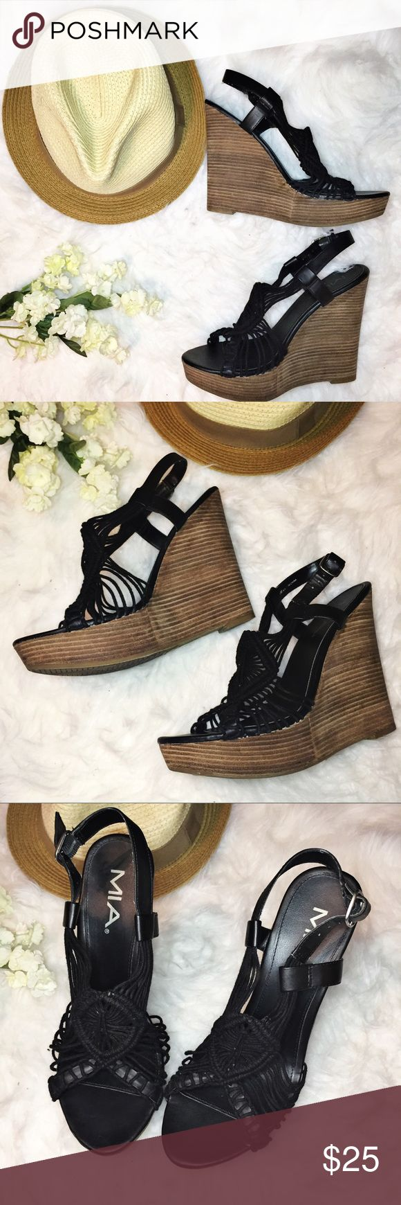"""MIA - black rope and wood grain wedges Pre-loved. Only worn a couple of times (see bottom of shoe). No chips, no tears; still in good condition. I find that they run big, I'd prefer a half-size down because you tend slide towards the toes. Wedges are 5"""" high. Does not have it's shoebox. MIA Shoes Wedges"""