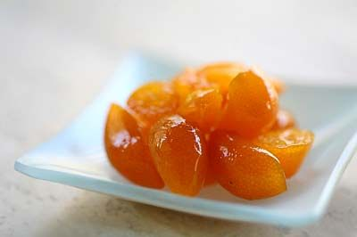 Super easy recipe for candied kumquats. My tree is loaded and I've got to do something with them!