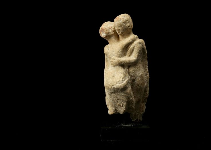 Greek Tanagra terracotta figure of a couple embracing, 4th century B.C. Possibly representing Cupid and Psyche, in a tender embrace, 10cm high. Private collection