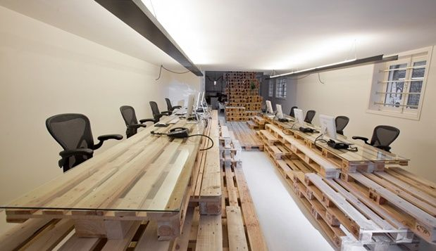 Amsterdam's BrandBase cleaves to the notion that less is more. The office's furnishings and staircases are made of wooden pallets that look elegant, but invite informality. (Designer: Most Architecture)