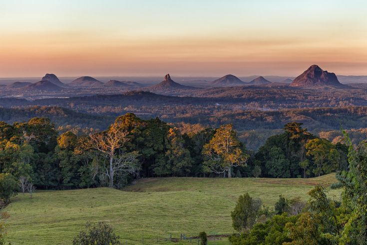 https://flic.kr/p/ojKUze | Glasshouse Mountains | Glasshouse Mountains from Mary Cairncross Park, near Maleny. The highrise buildings of Brisbane can just be seen on the horizon in the middle of the frame.