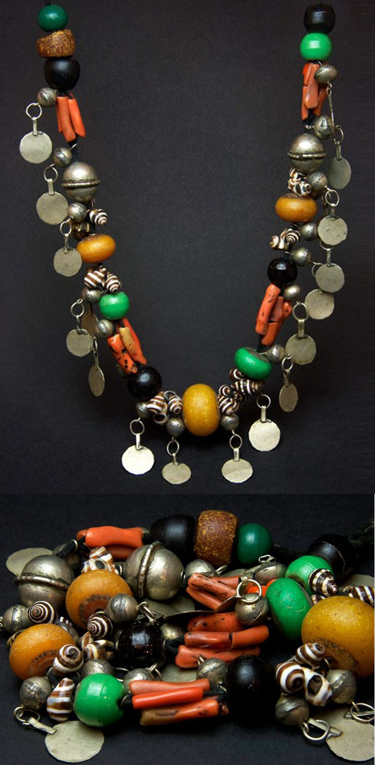 Morocco | Old Berber necklace or head ornament from Foum Zguid (close to the oasis of Jebel Bani in the south) | Silver, coral, amber, resin, shells, mixed metals | Mid 20th century | Sold
