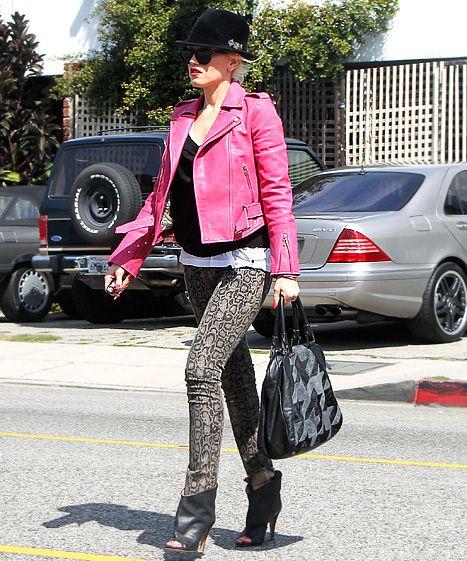 Gwen Stefani worked daring snakeskin David Kahn straight leg jeans