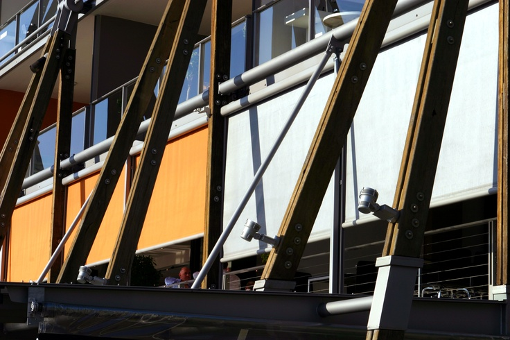 Modern Outdoor Retractable Blinds and Awnings. Check out the design flair this King Street Wharf restaurant added to its facade by installing external Issey Vertiroll blinds in orange and white.