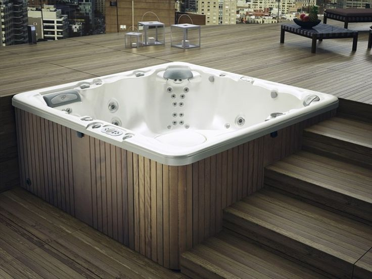 Here's a cool hot tub stepped decking example that may give you some ideas.