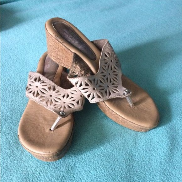 beige sandal wedge  size 10 Used beige sandals good condition but picture show bottoms so there  no secret they have been used . Come as is . No rips or stains in front of shoes just bottoms gave scuffs . Shoes Wedges