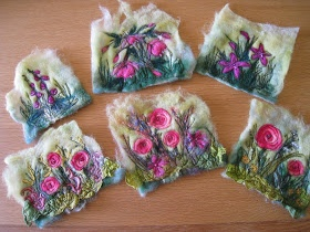 felting or dumfing wet felt back ground with needle felted embellishments.....and,of course, beads