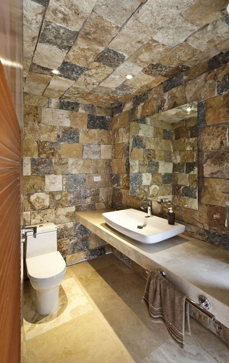 Pics Of The rustic tile choice gives this cosy bathroom a rugged purposeful appearance Very smart