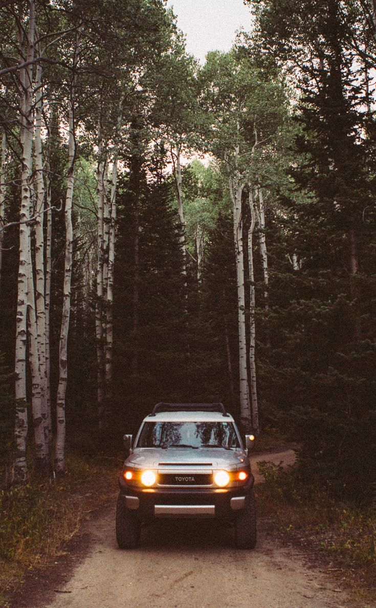 Toyota FJ Cruiser in the mountains among-st trees. Park City Utah.