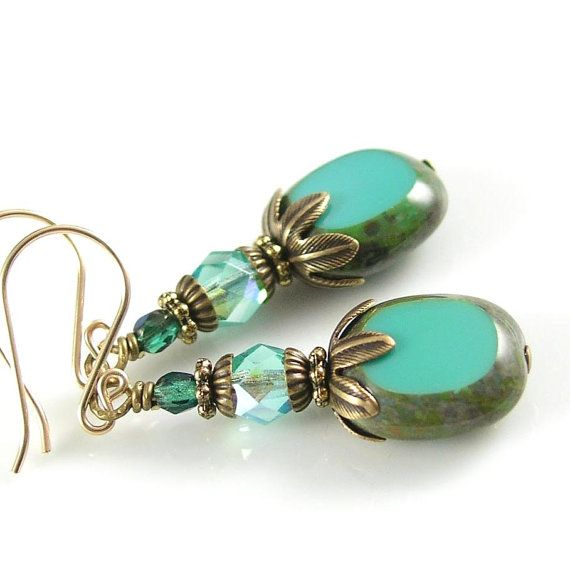 Jewelry with a classic touch and vintage elegance. Perfect for any occasion! - Choose your Ear-Wires: handcrafted 14K Gold Filled French Hooks or Top Quality Antique Gold Brass Lever-Backs (made in USA - hypoallergenic) - Beautiful pressed Czech glass oval drops in Vintage Turquoise with Picasso finish, 12x14mm - Czech Crystals in Aqua and Teal, 4 & 3mm - Top Quality Brass components including beautiful leaf bead caps(lead and nickel free) in Antique Gold. These caps are made in the U.S.A…