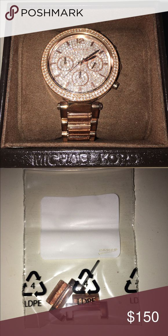 Michael Kors Rose gold Women's Watch Rose gold sparkly face with sparkle rose gold band. Complete with additional links to change sizing. Michael Kors Accessories Watches