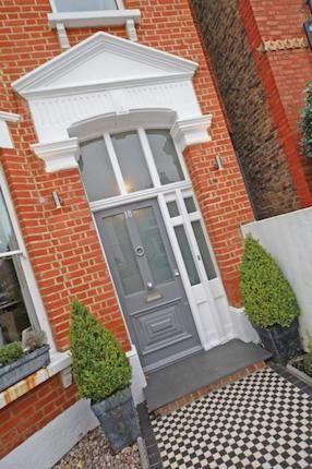 grey front door Hillersdon Avenue, London