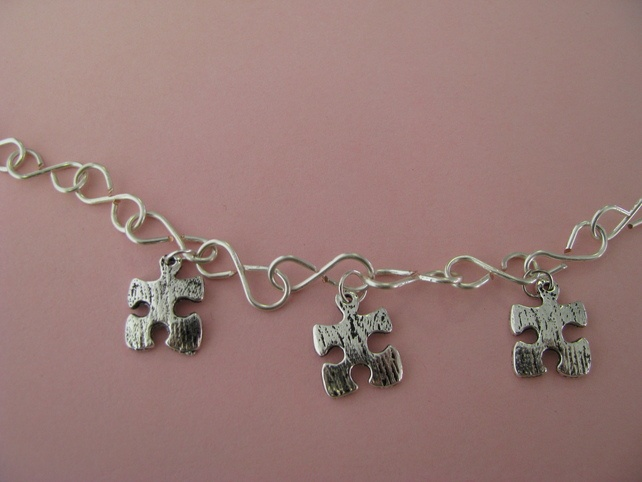 Charm Necklace (Commission) £12.00  Made especially for me, the jigsaw pieces represent my 3 autistic loves.