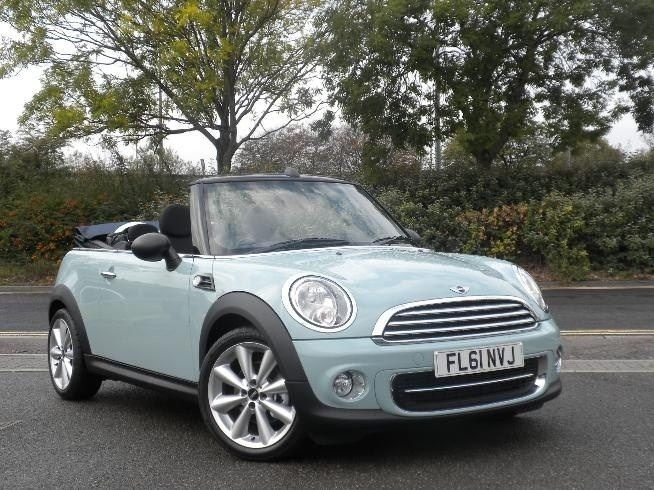 Ice Blue Convertible Mini Cooper 6-speed: this is my car and I love her. Thank you, Brits!
