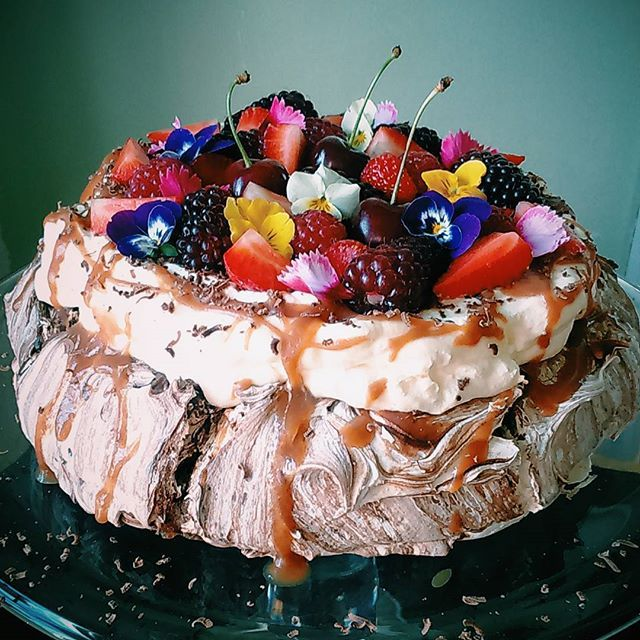 Rebecca Jane Sugar Art Dark chocolate swirl pavlova with cream, salted caramel, choc, berries and edible flowers.
