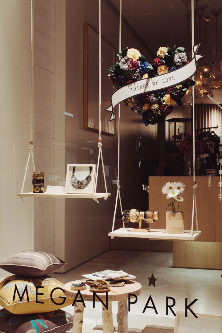 This swing idea is cheap and effective display the for Boutique window display ideas